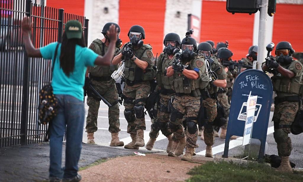 Armed-police-confront-a-protestor-fergison
