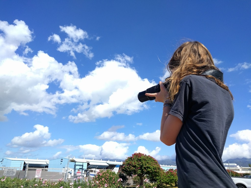 Seamus taking pictures of planes and HNL airport.